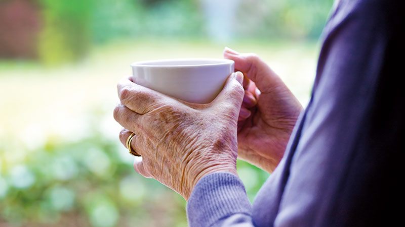 Elderly lady holding a mug